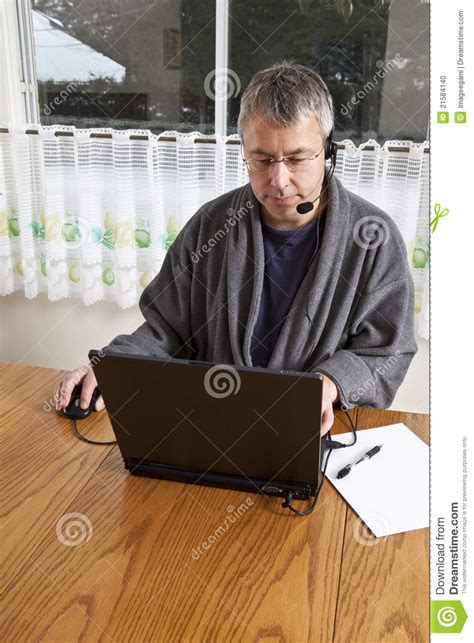 Businessman Working From Home In Pajamas Stock Photo